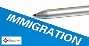 A pen with the word Immigration
