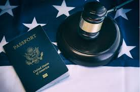 Passport and gavel atop an American flag