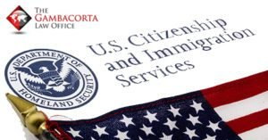 U.S. citizenship and immigration services paperwork and an American flag