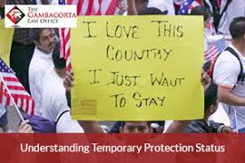 "person holding a sign that says ""i love this country. i just want to stay."""
