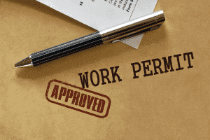 "Work permit with a stamp that says ""approved"""
